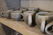 mugs on shelf close up small